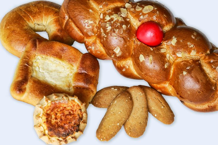 A traditional Greek Easter bread, baked with a red-dyed egg on top, covered with two strips of dough in the form of a cross. This is a very sweet bread, delicately flavored withanise.
