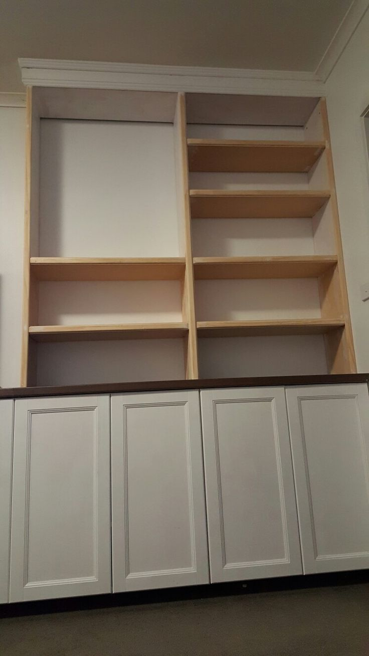 View from the floor.... I'm exhausted!  All shelves are trimmed too.  I used two shelves then a trim to hide the middle seams.