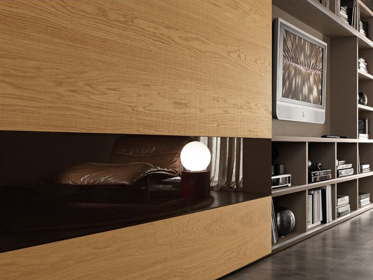 "PRESOTTO | Pari & Dispari bookcase with creola ""aged"" oak sliding doors. The special surface treatment sets off the wood grain and makes it perceivable to the touch. _ Libreria Pari & Dispari con ante scorrevoli in rovere vissuto creola. Il particolare trattamento della superficie, esalta le venature del legno rendendolo percepibile al tatto."