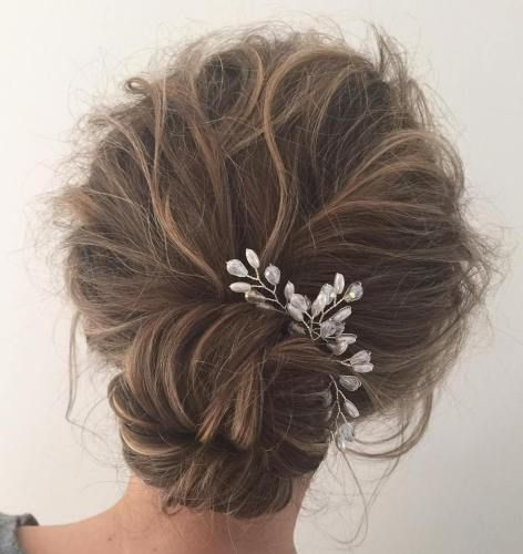 Low Tousled Updo With Sock Bun | For more style inspiration visit 40plusstyle.com