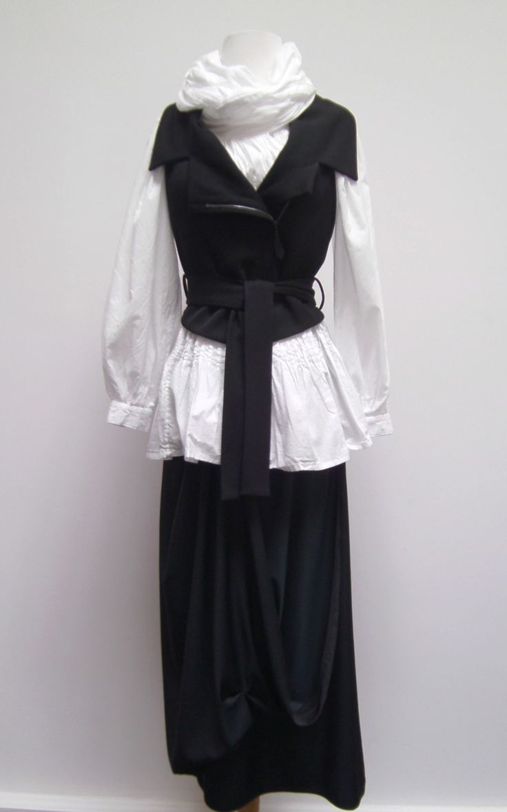 Annette Gortz vest over an Ivan Grundahl knife pleat tie blouse and paired with a BNG drape front skirt.