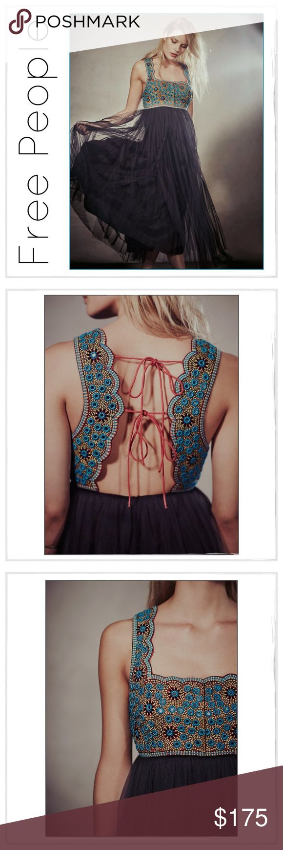 """✨Free People 'Midnight Kiss' Dress✨ ✨Free People 'Midnight Kiss' Dress✨This gorgeous maxi features a vibrant bodice, embellished with mirrors framed with intense turquoise embroidery✨Scalloped neck with corset style hook and eye closure✨Deep dip scalloped back with two tie closures✨Knotted net skirt with hidden zip closure in back✨Approx 50"""" Long✨NWT✨Size 6✨ Free People Dresses Midi"""