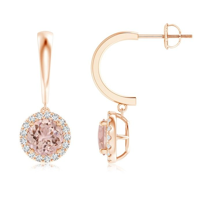 Dangling Round Morganite Hoop Earrings with Diamond Halo. Both playful and opulent, these dangle hoop earrings will bedazzle you with their unique design. The prong-set round morganites sit within a glimmering halo of U pave-set diamonds.