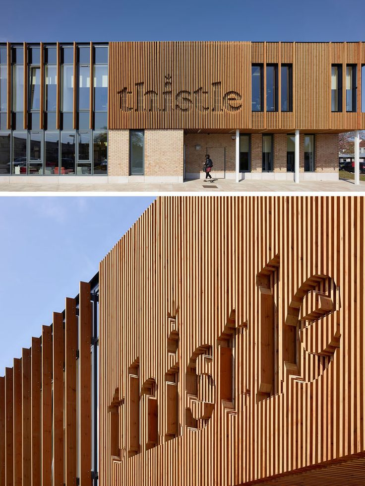 This office building has their logo integrated into the design of the wood siding.