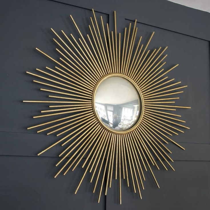A fabulous classic gold sunburst mirror .This stunning antiqued gold wall mirror will bring an instant touch of glamour to any room in your home . It is on trend with the season's gold and luxe accessories and the sunburst style will remain timeless and elegant. It would make a beautiful gift for a wedding or special anniversary.steel , wood , glassDia : 100cm