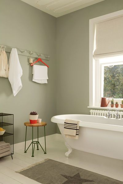 Pale, muted greens make for a serene bathroom space. Try Overtly Olive on bathroom walls with splashes of bright red or coral to add a twist.