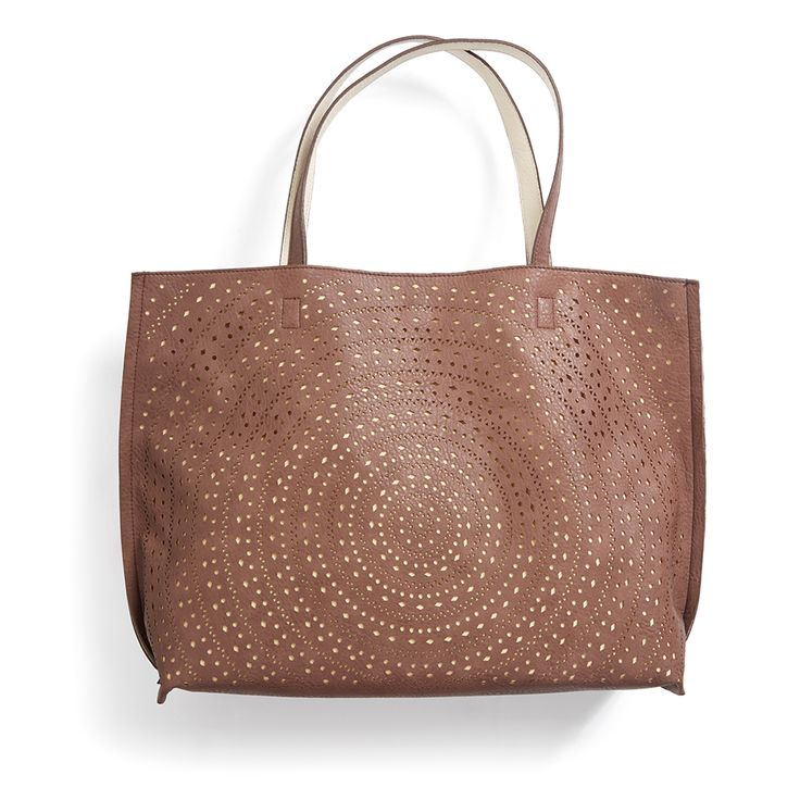 Try a laser cut tote this season for a fun twist on a classic staple. Stitch Fix   Kaelyn Laser Cut Two-Tone Reversible Tote
