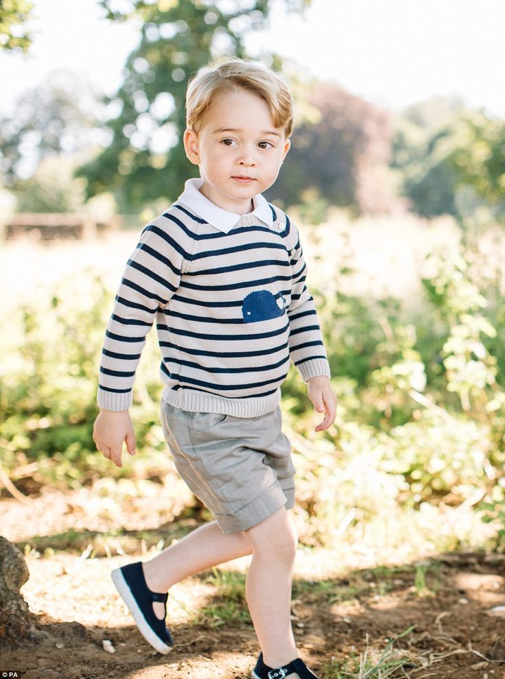 Dressed in a striped jumper and his favourite Trotters shoes, Prince George looks cherubic...