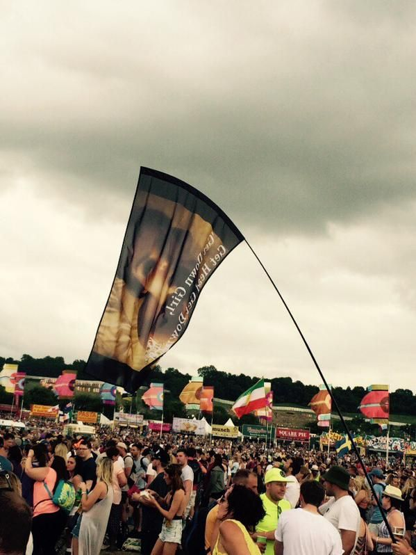 Flag of Kim Kardashian sucking Ray J's dick at Kanye's Glastonbury set