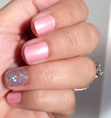OPI's Italian Love Affair (opaque light pink) and topped it with OPI's Princesses Rule! (pink shimmer). For my glitter nail, I used several coats of OPI's Servin' Up Sparkle.