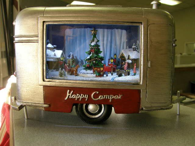 Cute Christmas toy RVs here in our parts department! Get them quick cause we are selling them fast! They light up and the train turns! Plays more then one song!