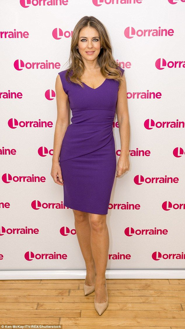 Purple reign: Elizabeth looked incredible in a form-fitting purple dress which she teamed ...