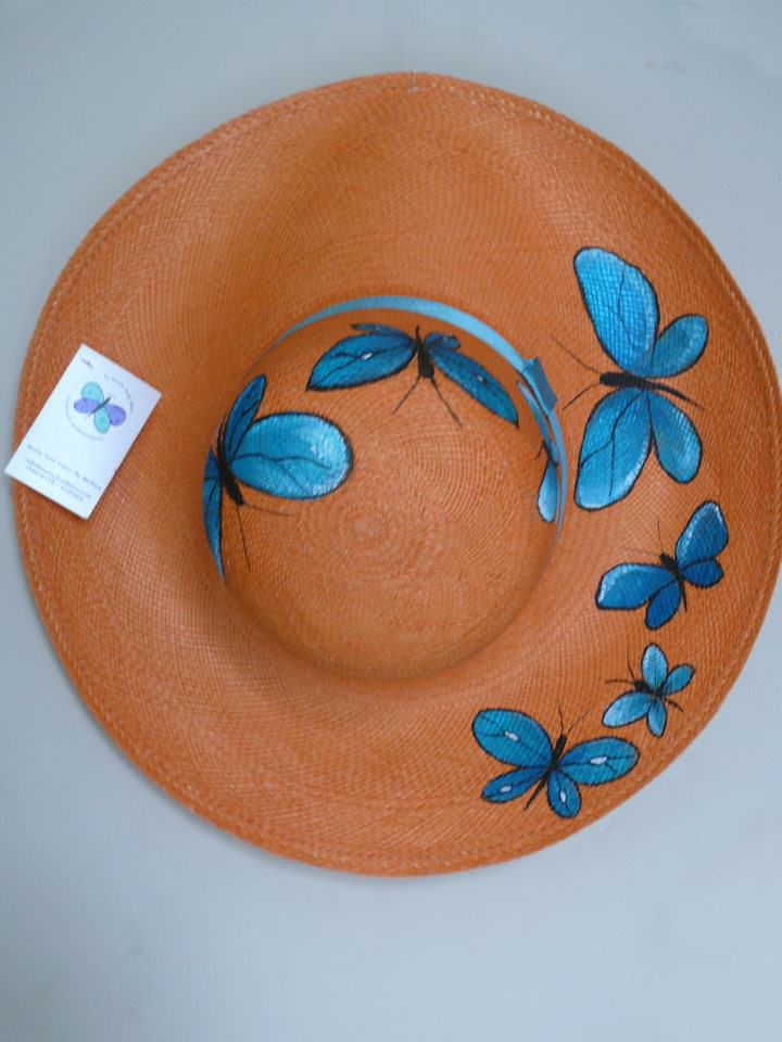 Weaved Panama hat featuring a hand-painted Blue Morpho butterfly design. Get your very own hand painted genuine Panama hat straight from the source in Ecuador. All hats are hand painted by artist María José Félix in Guayaquil, Ecuador. The hats are 100% woven toquilla straw. Slight variations in design and color will occur, as each hand-painted hat is...