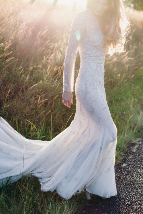 Chic long-sleeve white wedding dress with beaded details; Featured Photographer: Rachel Kara
