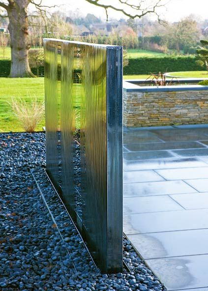 Simple stainless steel water wall, beautifully reflecting its surroundings