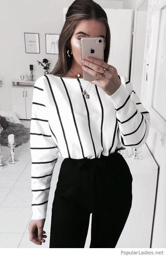 Printed blouse and black pants