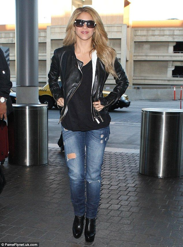 Fashion favourite: Shakira showed off her much loved denim style as she strode through the airport in Los Angeles, California, on Wednesday ...