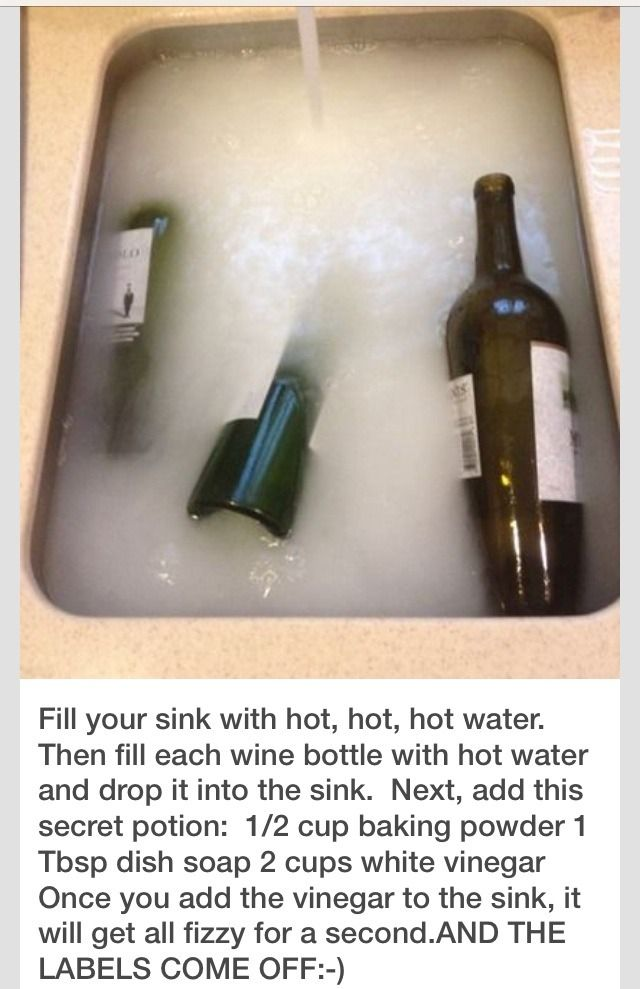 Fill your sink with VERY hot water. Then fill each wine bottle