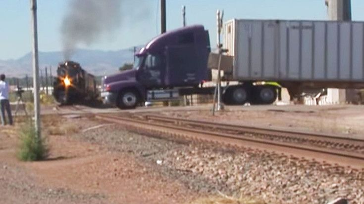 UP Challenger Gives Us A Close Up After Near Missing A Semi Truck! | Train Fanatics Videos