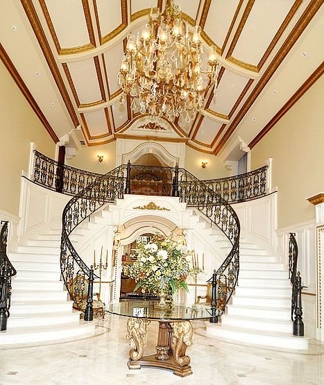 Unique ceiling, beautiful chandelier, and staircase at Melissa and Joe Gorga's house for sale.