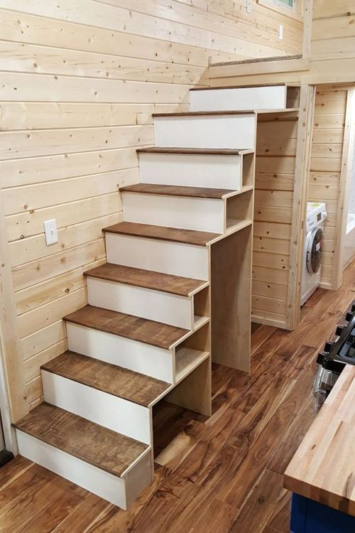 The storage stairs lead up to a loft.