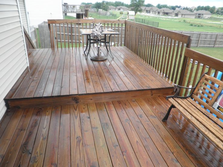 Cabot Semi-Transparent Redwood Stain on an existing Treated Deck | Deck and Drive Solutions