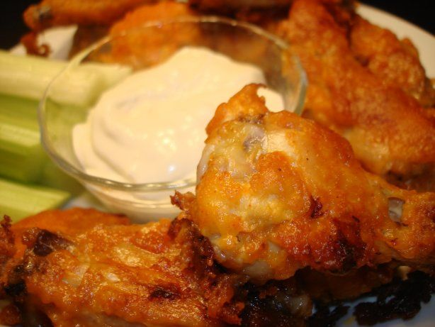 Easy Hot Wings that come out of the oven crispy without the hassle of deep frying.