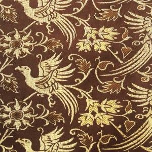 Brocade Italy, Brown and Gold A reproduction of an existing textile from 14th century Italy stored at the Metropolitan Museum of Art. We offer this fabric in brown colour. The brocade is densely woven from fine silk, rayon and metallic threads, creating a feel of true luxury.