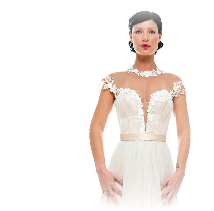 """A feminine touch on a """"Dimitris Katselis """" bridal dress with boho lace on nude tulle."""