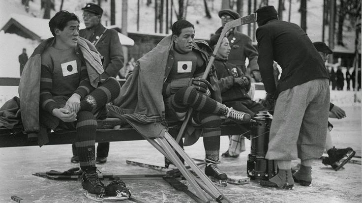 of the Japanese ice hockey team take a break during their match against Great Britain at the 1936 Winter Olympics in Garmisch-Partenkirchen, Germany. (Allsport Hulton/Archive)