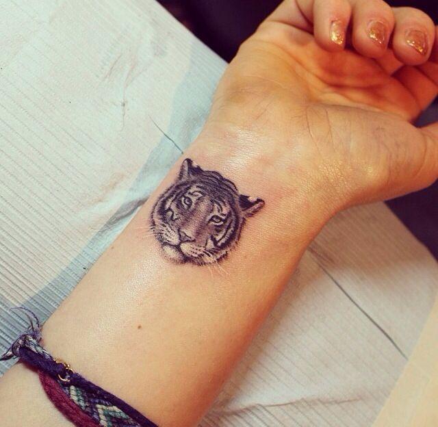 tiger tattoo hand                                                                                                                                                                                 Mehr