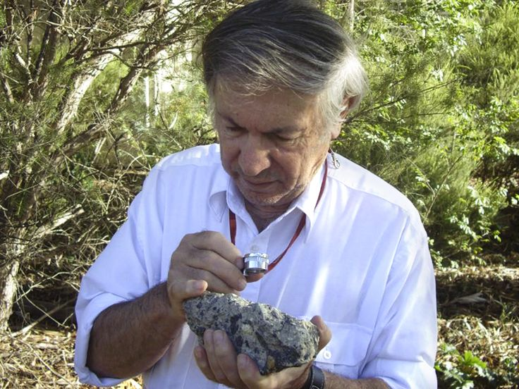 Dr Andrew Glikson with a sample of suevite - a rock with partially melted material formed during an ... - D. Seymour via Australian National University