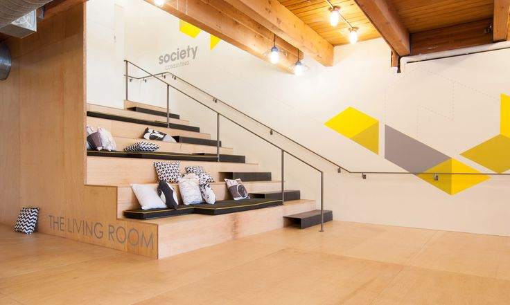 This kind of staircase/theater space isn't uncommon in office design (the perfect spot for those all-team meetings), but I wonder if you could pull it off in a residential space, where the staircase to the 2nd floor marries with a home theater seating/rec room space.