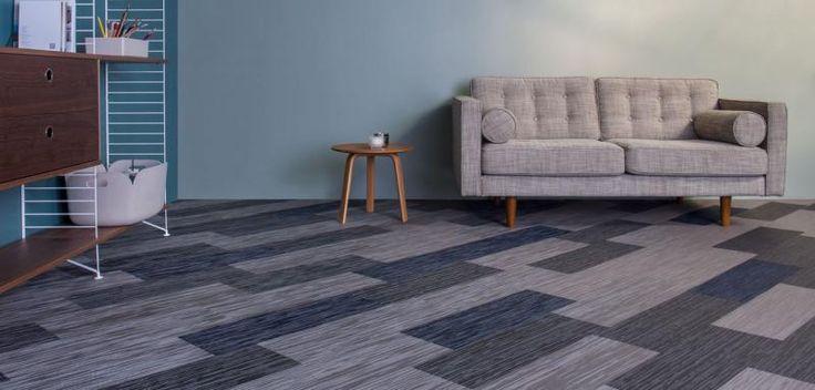 Šedé odstíny podlahy z tkaného vinylu Fitnice. / Gray floor from the Fitnice woven vinyl.