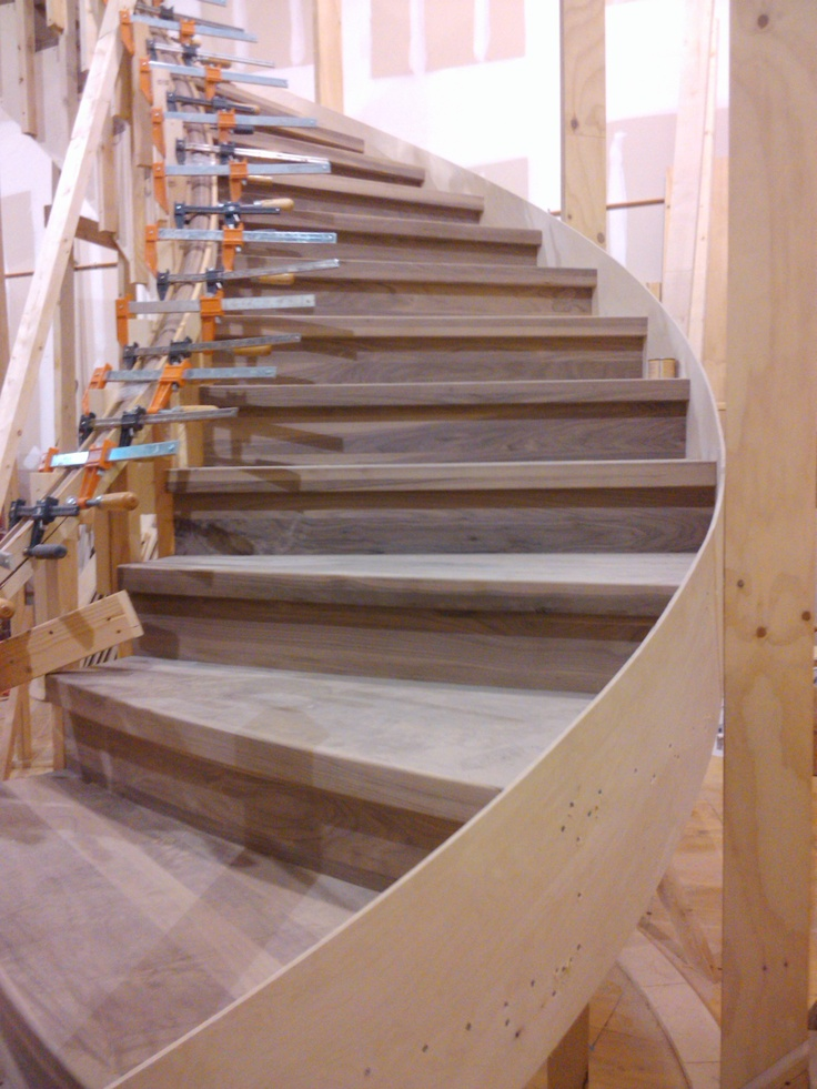 Walnut curved stair with squared treads