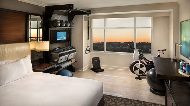 In Hilton's New Fitness-Friendly Rooms, You Can Literally Roll Out of Bed and Into the Gym