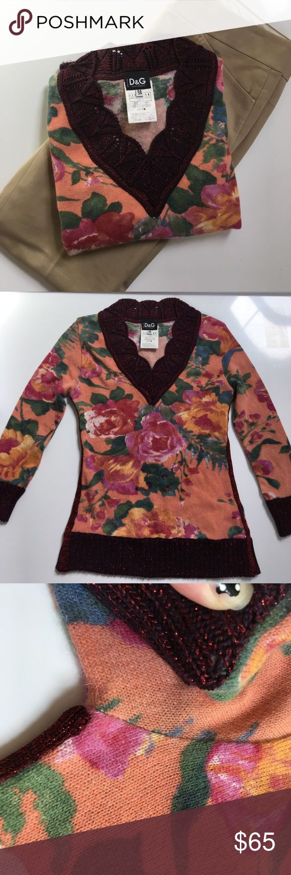 """{ Dolce & Gabbana } sweater shirt D & G sweater shirt in 34% nylon 34% angora 21% wool 7% acetate 4% other. 7/8 sleeves, v neck, knit trims, back has leather logo tag that's sewn on I had to fix by restitching on since one side was loose. Previously worn and has normal wear to it and a few spots that the knit is a little """"pulled"""" looks almost like a hole (see picture example please). Measures approx laying flat pit to pit 15""""mid shoulder down 21"""". Has light stretch only. So cute and comfy…"""