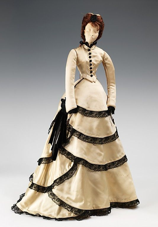 """""""1870 Doll"""" with costume by the House of Balenciaga, made in 1949 as part of the Friendship Train. This dress was inspired by one made for Princess Metternich, a great patron of the arts who was responsible for introducing Charles Frederick Worth to the Empress Eugenie, his greatest client."""