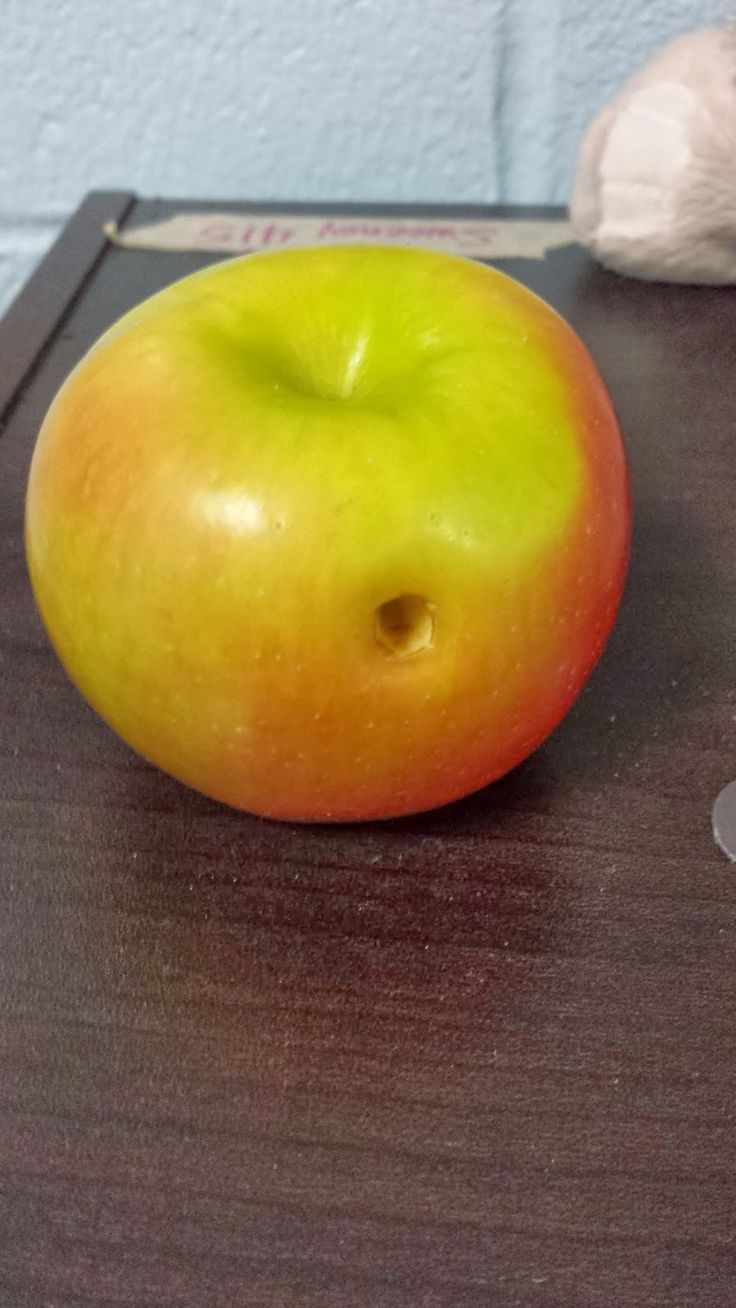 Hole in Apple to demonstrate cavity in tooth