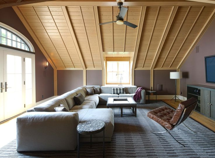 Morgante Wilson Architects designed this recreation room with comfort as the main focus.  A deep sectional is covered in Opuzen felt.  The media cabinet is designed with metal doors and wood top.  The walls are painted Benjamin Moore Desert Shadows.