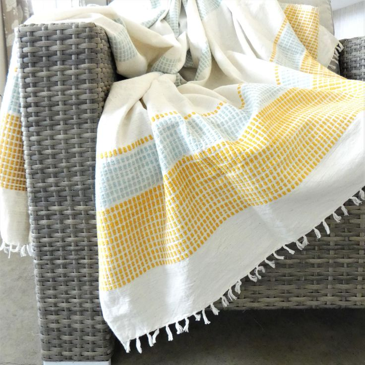 Exquisitely hand spun & woven by a small group of talented Ethiopian artisans, the lightweight Camden Cotton Blanket is the perfect addition to a picnic, beach trip, living room spread, or used to wrap up on a cool evening.  Handcrafted with skillful hands and careful attention, each piece has unique qualities in natural texture, softness, and colour.  100% locally sourced eco-friendly cotton and dyed with AZO-free colour.  Dimensions: 142 cm x 198 cm