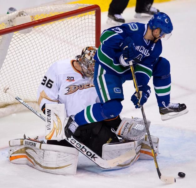 Daniel Sedin -- flying in the crease!