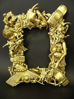 Great idea for all those toy soldiers etc we are collecting! Toy frame by RosieConnell, via Flickr