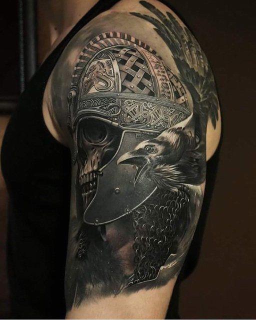 scandinavian warrior skull in helmet tattoo on shoulder