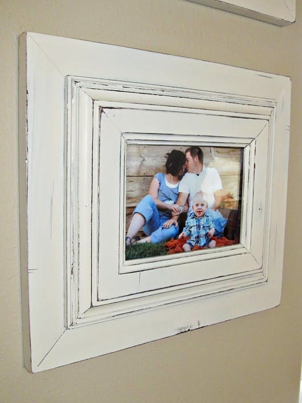 Reworking Boring Picture Frames - two plain frames were painted, distressed and glued together.  Now these layered frames and picture have some pizzazz and make a statement - via Lovely Little Snippets: Quick Frame Makeover!