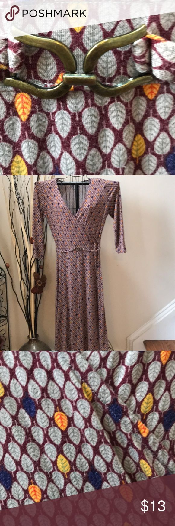"""Gorgeous Downeast dress This beautiful dress is in good condition! It's has a beautiful brass buckle on the waist! It goes perfect with feather design of the dress! Bust is 34"""" waist is 30.5 and it's 40"""" in length Downeast Dresses"""