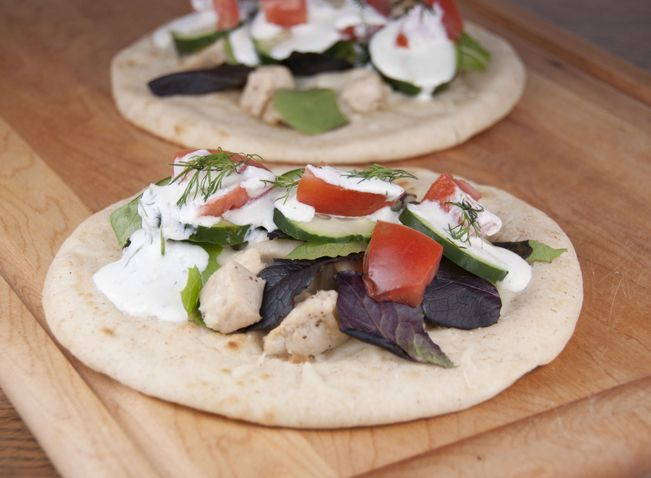 These grilled Greek chicken pitas with a simplie Tzatziki sauce are fun to make, easy and delicious! Great weeknight dinner recipe idea for the summer.