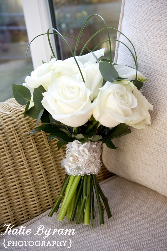 Contemporary Wedding Bouquet Showcasing: White Roses, White Calla Lilies, Green Rose Foliage + Green Bear Grass Loops >>>>