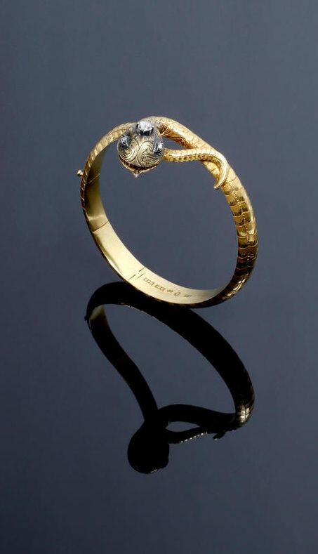 A Swedish mid 19th century diamond set serpent bangle.