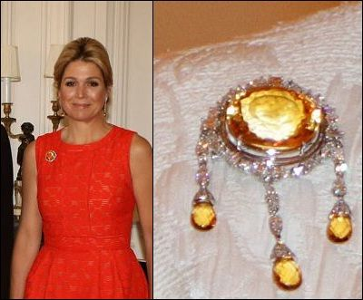 Queen Máxima of the Netherlands wearing a very large topaz or citrine brooch.